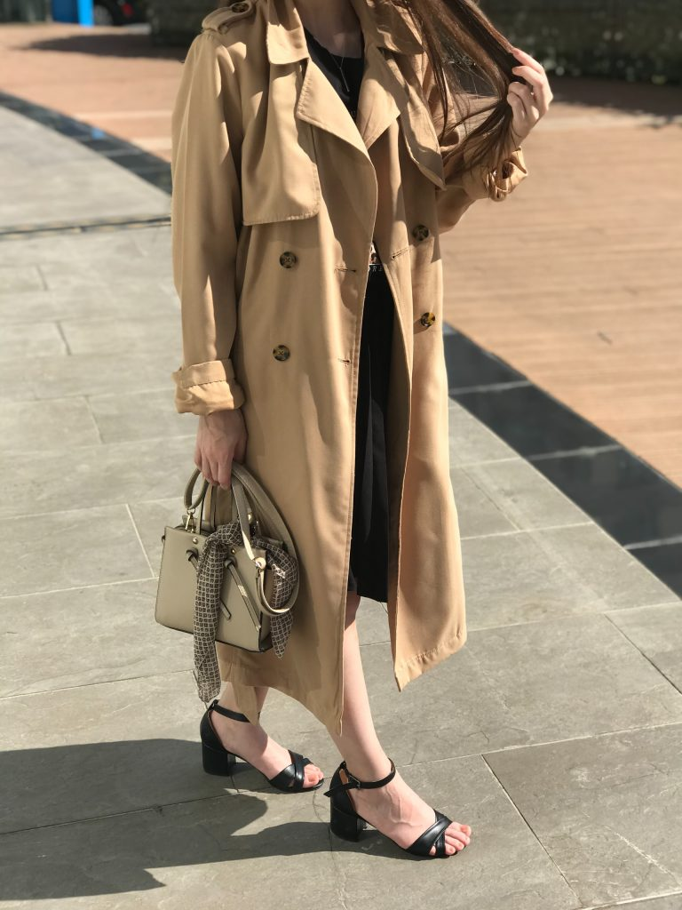 a woman in beige trenchcoat