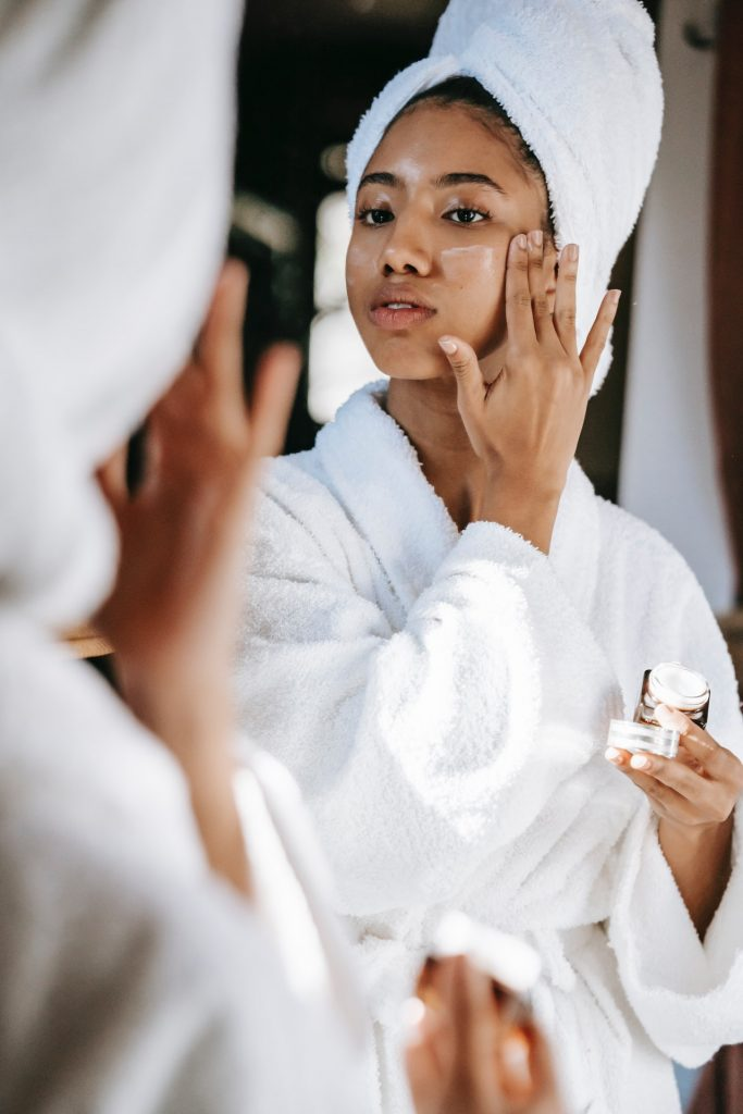 woman putting face cream on